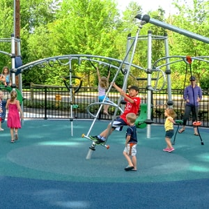 Colorful modern playgrounds with play equipment, swings and spinner toys for every age range