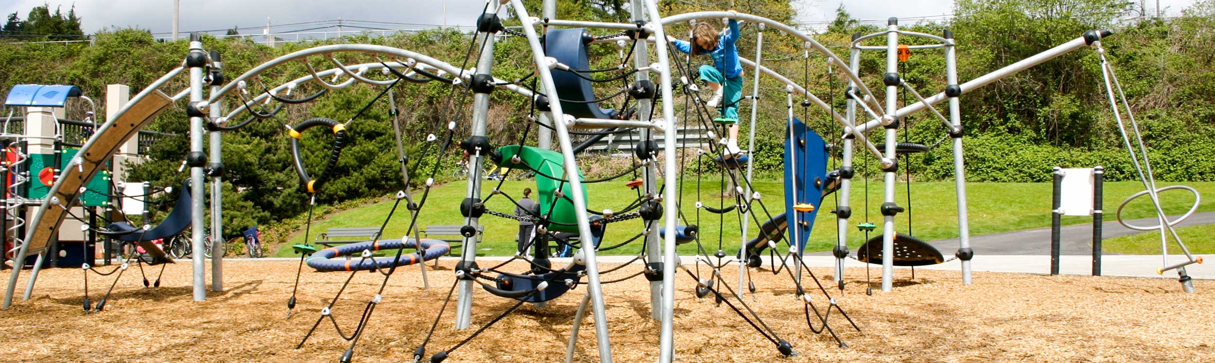 Modern swing, rope climber and spinner playground