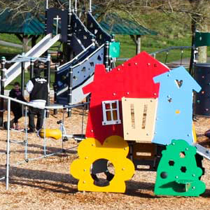 Toddler play area with brightly colored pretend play structure